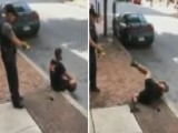 Cop Uses Stun Gun On Man Sitting On Curb