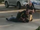 Cop Fights Off Suspect As Bystanders Watch