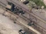 Crash Involving Dump Truck, Train Leaves Two Dead