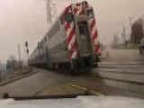 Cop Nearly Crashes Into Oncoming Train After Crossing Gates Fail To Lower