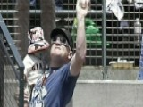 Dad Catches Baseball While Holding Son