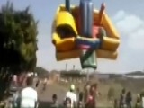 Dust Devil Rips Bounce House, Boy Into The Air