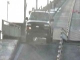 Distracted Driver Crashes Gate, Goes Airborne On Drawbridge