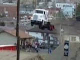 Daredevil In Semi Shatters Truck Jump Record
