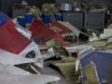 Dutch Team Examine Possible Missile Parts At MH17 Crash Site