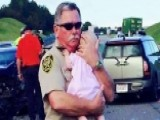 Deputy Comforts Crying Baby After Car Crash