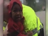 Dramatic Video Shows Crews Rescue Child From Sinking Car