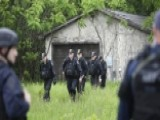 Escaped Killers May Be Armed In Rugged Terrain