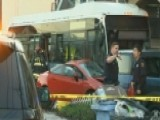 Emergency Crews Survey Damage After Bus Crashes Into Homes