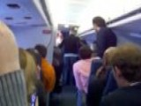 Flight Attendant Goes Berserk En Route To Chicago