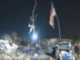 First Responders Raise Flag After Devastating Tornado