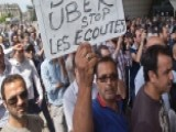 French Taxi Drivers Smash Cars In Protests Against Uber