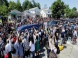 Fans Line Streets For Muhammad Ali Funeral Procession