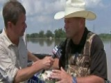 Fort Bend Sheriff Delivers Feed To Cattle Stranded By Flood