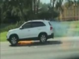 Florida Woman Alerts Driver That SUV Is On Fire