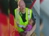 Firefighter Cradling Baby After Car Accident Goes Viral