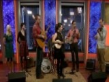 Gospel Folk Band Performs 'Angels We Have Heard On High'