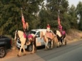 Girls Carry Flags On Horseback To Thank First Responders