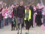 Hero Who Saluted From Hospital Bed Walks Across Finish Line