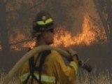 Hundreds Of Firefighters Battle Blazes Across West Coast