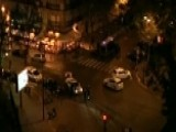 Heavily Armed Police Gather Outside Paris Hotel