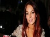 Lindsay Lohan Charged With Assault