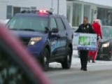Local Cops Make Some Motorists' Christmas Wishes A Reality