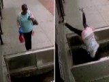 Look Out Below! Distracted Woman Tumbles Into Sidewalk Hatch