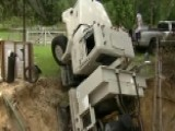 Massive Sinkhole Swallows Utility Truck