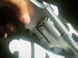 Man Posts Video Showing Loaded Gun Behind A Police Car