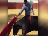 Matador Holds Infant Daughter While Bullfighting