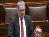 Musical Christmas Tie Interrupts Irish MP's Speech