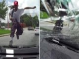 Man Jumps Onto Moving Car, Kicks In Windshield