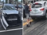 Man Smashes Out Windows Of SUV Trying To Flee Accident Scene