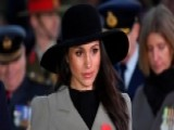 Meghan Markle Sports Trench Coat After Dress Controversy