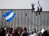 Migrant Caravan Makes Mass Push For Asylum