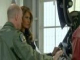 Melania Trump Tours Military Bases And Navy Aircraft Carrier