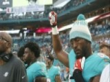 NFL Players Kneel, Raise Fists During Anthem
