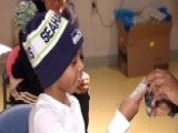 Officer Surprises 9 Year-old Shooting Victim With WWE Gift