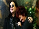 Ozzy And Sharon Osbourne Kiss For The Cameras