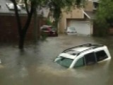 Officials Search Flooded Houston Neighborhoods For Victims
