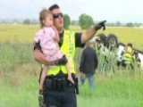 Police Officer Calms Fears Of Frightened Little Girl