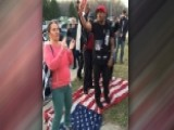 Protesters Trample American Flag Outside Trump Rally