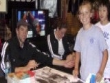 Photo Shows 9-year-old Ledecky Meeting Swim Idol Phelps