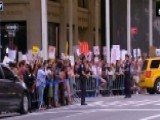 Protesters Await The President's Arrival At Trump Tower