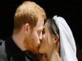 Prince Harry, Meghan Markle Kiss For Cheering Crowds