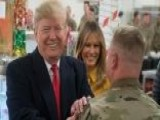 President Trump's Unannounced Visit To US Troops In Iraq: A Look At The Political Implications Both At Home And Overseas