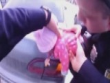 Quick-thinking Police Officers Save Choking Baby