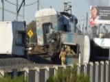 Report: Truck Driver Fled Scene Of Commuter Train Derailment