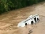 Raw Video: Flood Waters Wash Cars Away Downriver